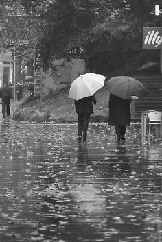 walking in the rain..call me crazy but I find this very romantic,