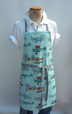 """Made specifically for the man in your life, the Dodge City apron is wider and longer than our traditional unisex apron - easily fitting a 6'5"""" man. Durable fabric and extra stitching make sure that it"""