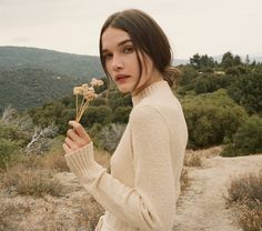 In boucle cotton jersey, the DOEN Anka Dress is the updated vintage style sweater dress of your winter dreams. With a mock neck and attached wraparound belt, this dress has a form-fitting fit that fla