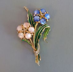REJA flower bouquet brooch with pink and blue moon glow from Morning Glory Jewelry. Buy now for $148.00