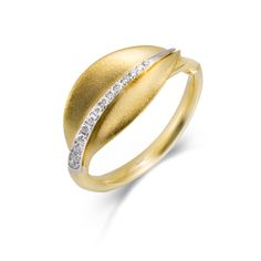 This fabulous 18K white and yellow ring is comprised of .09ctw round white Diamonds.