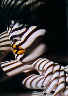 Black shadow stripes over pale white face and arms, pretty dahlia yellow…