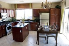 Traditional Dark Wood (Cherry) Kitchen Cabinets - light floor and dark counter tops