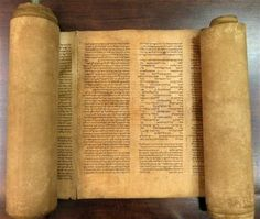 In this undated photo provided by Alma mater Studiorum Universita' di Bologna, a document that an Italian expert says to be the oldest known complete Torah scroll.
