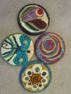 These are hooked rug trivets,but I see needle felting trivets!