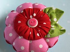 Pink, red and green make a wonderful color combination.   Add some sweet polka dots into the mix.     Top it off with a puffy yo-yo flower. ...
