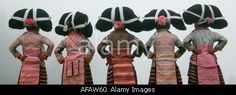 Long Horn Miao little girls in traditional costumes dancing to celebrate Flower Dance Festival Guizhou China © Keren Su/China Span / Alamy