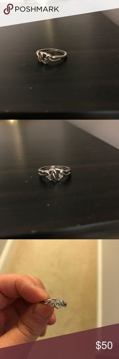 Sterling silver love knot ring with diamond chips Sterling silver ring with diamond chips! This was sized so if I had to guess it's between 5.5 and 6.  Ring holder not for sale Jewelry Rings