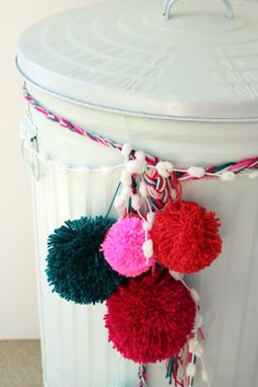 pom poms on the trash can. cute.