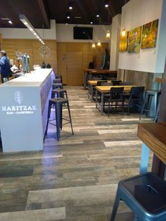 #Wood & #stone come together to bring a cozy & modern atmosphere to this Bar & Coffee Shop in Vitoria (Spain)