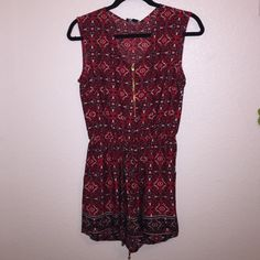 Red patterned romper! NWT A really nice satiny feel. NWT and has never been worn! Super adorable and comfortable. A drawstring waist with a tie. Zipper on the front. Not from Forever 21! Forever 21 Other