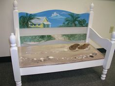 Beach art bench made from twin head board and foot board.