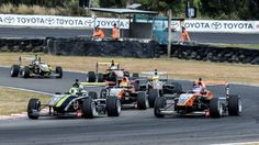 Ferdinand Habsburg in car No 62 overtakes Lando Norris (31) after the second safety car at the New Zealand Grand Prix in Manfeild on Saturday.
