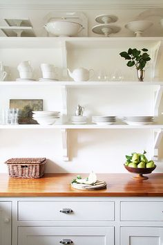 Open shelving, always styled perfectly at A Country Farmhouse. Not keen on the dusting involved, but love the look.