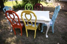 This is sorry of what I plan to do with my table set: white table and chairs a bright color. But just one color. I'm leaning towards yellow.