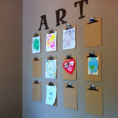 Child's Art Wall. Hang clipboards to display your child's art. More space than your fridge and a great way to fill that big empty space on your wall. (P.S. I adapted this from an idea another pinner shared on Pinterest.)