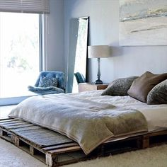 You know in the house and rooms a Bed is necessary thing and in the picture a simple pallet bed is shown which is looks much simple you can take rest on it easily and you can decorate more it with your think and you can make this type of furniture easily.