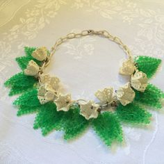 Vintage Celluloid and Early Plastic Flowers & Leaves Bib Necklace