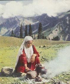 Kazakh nomad woman brews tea, 1954