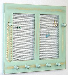 What a gorgeous idea. Get an old window frame and cross it with mesh for your earrings, then add knobs for necklaces. Love it.