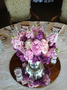 Soft pink peony, pink spray roses, soft pink stock and purple lilac centerpieces at Bakersfield Country Club. www.ahofdesigns.com