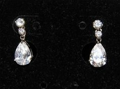 Lia Sophia retired dangle earrings with white cz tear drop  starting bid $6.00
