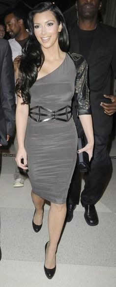 Who made Kim Kardashian's black clutch, gray one shouler dress, and black belt that she wore to LIV Nightclub in Miami, October 24, 2009?