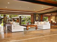 Glass pocket doors in the casual living spaces disappear completely to seamlessly blend indoors and out.