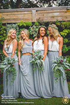 Revelry - Clara Skirt, $125.00 Revelry has affordable, trendy, and designer quality bridesmaid dresses and separates. Everything is available in endless colors and sizes 0-32! The Clara bridesmaid skirt is shown in Platinum Grey and paired with the Revelry Heidi and Eva bridesmaid tops. (http://wedding.shoprevelry.com/revelry-bridesmaid-dresses-clara-maxi-skirt/)