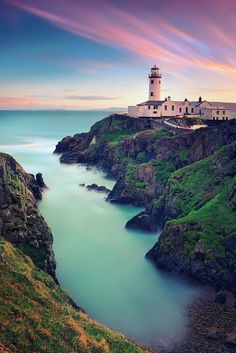 The Fanand Head Lighthouse in County Donegal, Ireland. I want to go see this place one day. Please check out my website thanks. http://www.photopix.co.nz