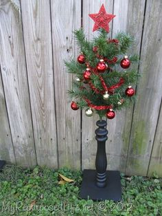Using upcycled chair spindles and some old Christmas tree branches make a perfect little Christmas tree for small spaces. Christmas Tree Branches, Christmas Tree Crafts, Little Christmas Trees, Diy Christmas Tree, Christmas Projects, Holiday Crafts, Christmas Holidays, Christmas Wreaths, Christmas Ideas