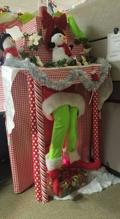 Cardboard Fireplace Mantel With Grinch Sliding Down It