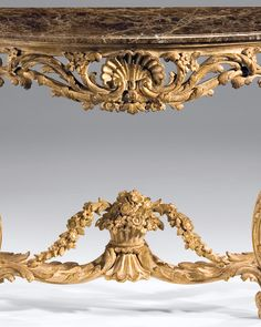 Louis XV carved console table - Louis XV style carved wood console table with shell motif in distressed gold leaf decape finish with brown Emperador marble top