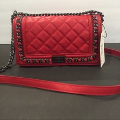 Red quilted leather chain bag Italian leather This is a genuine Italian leather bag. Gorgeous red color. Black chain with leather too strap. Size 25x13x9 cm Bags Shoulder Bags