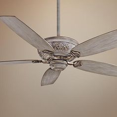 Decorative trim on the motor brings a handsome Old World look to this driftwood ceiling fan.