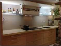 This modern kitchen is from the German brand E+K. The base units have an Oak veneer finish and house a magic corner and ample storage space. The worktops are 70mm thick Ceasar Stone. The wall units are in a High Gloss cream and have illuminated bases. Guide price £4999 Kitchen Sync, Kitchen Dining, Kitchen Cabinets, Ceasar Stone, Wall Units, High Gloss, Storage Spaces, Kitchen Ideas, Kitchens