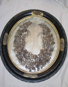 Very old human hair wreath...women would keep their hair, their daughters hair and down the line....take it from their hair brushes and wash and then braid them to make a generational wreath...these are rare to find