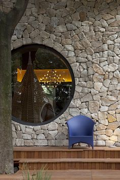 Love this stone & circle window... Urban Cabin by Fabio Galeazzo