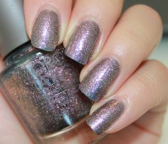 """Morgan Taylor nail lacquer. """"Who's That Girl?"""" Seriously the best glitter nail polish I've ever used... One coat full glitter coverage. A amethyst purple toned pick glitter that shifts from pink to gold. A bit on the thick side but easy to apply and the opacity is great."""