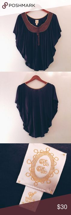 ANTHROPOLOGIE Ric Rac Navy Dolman Sleeve Blouse Comfortable and beautiful blouse from Ric Rac ANTHROPOLOGIE. Good condition. Brown and yellow paneled neckline. Navy blue. Soft and comfortable. Anthropologie Tops