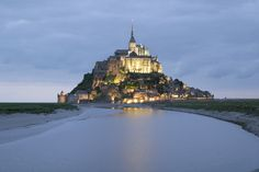 No, these aren't scenes from Lord of the Rings though this castle looks like it was taken straight out of a childhood fairy-tale or a fantasy novel! This is a rocky tidal island Mont Saint Michel located in France. Places Around The World, Oh The Places You'll Go, Around The Worlds, French Castles, The Mont, Living In Europe, Mont Saint Michel, Travel Memories, Beautiful Architecture