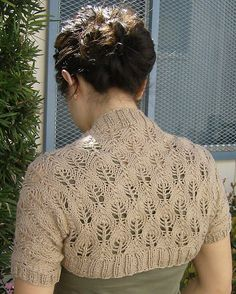 Free knitting pattern for Something Lacy Shrug, easy candle flame lace shrug…