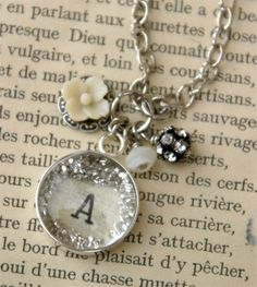 Initial charm necklaces.