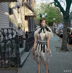 Lena Dunham in Alexander McQueen black-and-white high-collar feather dress and matching caplet; reminiscent of a FLAPPER DRESS!