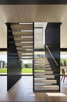 dining area modern stair treads of the house in East Hampton, New York