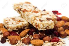 7422128-Granola-bar-with-dried-fruit-and-nuts-on-white-background-Stock-Photo.jpg (1300×866)