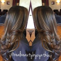 Face framing highlights warm light caramel tone on dark brown hair with layered cut - Yelp