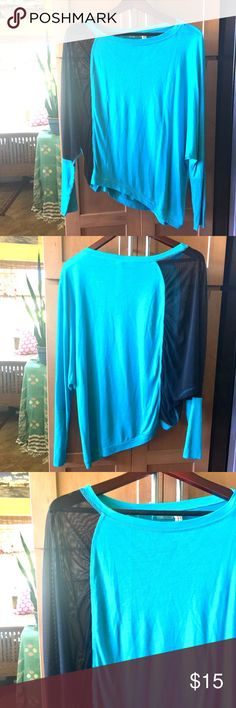 Turquoise and Sheer Black Asymetrical top Turquoise and Sheer Black Asymetrical top. Never worn perfect condition. Super cute top with unique asymmetrical design. Says XS but can fit Small as oversized and Medium regular fit. So listing as Small. Karma Tops