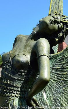 """USA: Florida: Sarasota County: City of Sarasota: Close-up of """"The Butterfly Lady"""" bronze sculpture by August Moreau, one of many public art installations in Sarasota's walkable downtown."""