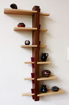 """The Echols wall shelf.  Exacting joinery with relaxed, flowing lines.  Shelf edges evoke an """"X"""" as well as that of a leaning hourglass. www.mattdownerdesigns.com"""